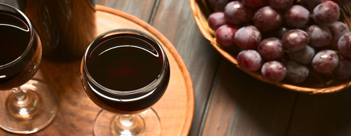 My Space-ITC My Fortune, Bengaluru-2072_bigstock-Red-Wine-in-Glass-with-Grapes-85799294.jpg