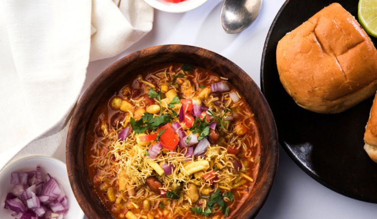 Neighbouring state Maharashtra's famous dishes have their own appeal and Gujaratis are relishing the spicy taste of these dishes